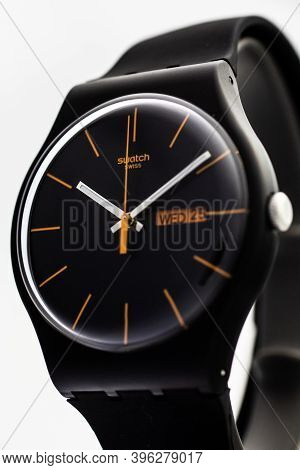 London, Gb 07.10.2020 - Swatch Cheapest Swiss Made Quartz Watch Close Up Isolated On Black Backgroun