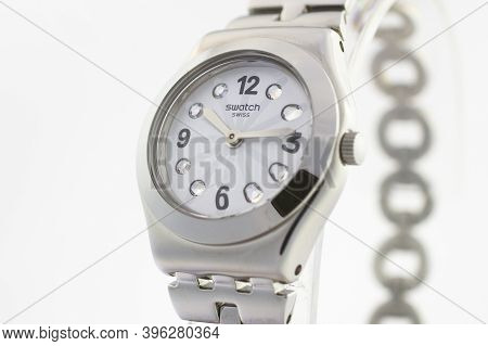London, Gb 07.10.2020 - Swatch Classic Design Swiss Made Mechanical Watch Close Up. Metal Case With
