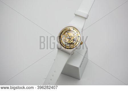London, Gb 07.10.2020 - Swatch Swiss Made Womens Quartz Watch On White Backdrop. Plastic Case Open C