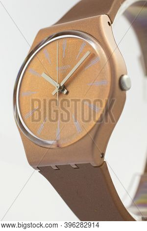 Rome, Italy 07.10.2020 - Swatch Fashion Swiss Made Quartz Watch On Stand Close Up. Beige Case Stylis