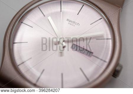 Geneve, Switzerland 07.10.2020 - Swatch Swiss Logo On Beige Wristwatch Dial Of Swiss Made Mechanical