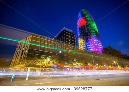 BARCELONA - NOVEMBER 24: Torre Agbar office building, illuminated at night, with traffic lights, on November 24, 2012 in Barcelona, Spain