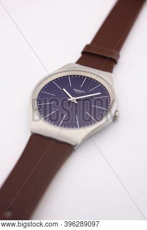 Rome, Italy 07.10.2020 - Swatch Swiss Made Quartz Watch Close Up. Metal Case Classic Design Blue Dia
