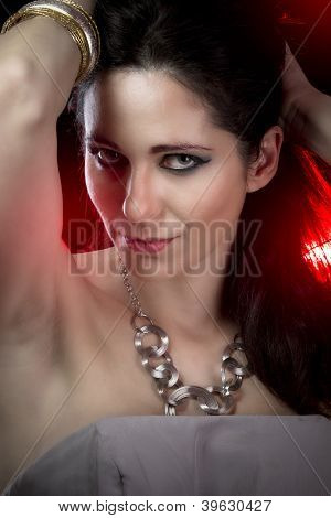 Brunette with evening make-up. Jewelry and Beauty. fashion photo