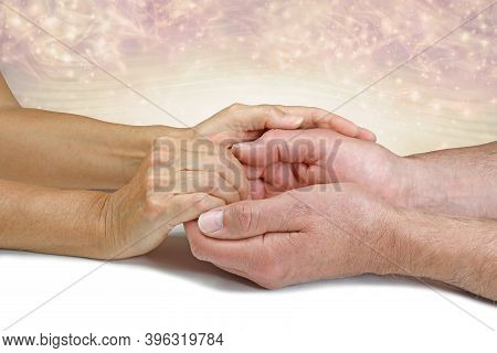 Transferring Healing Intention During Energy Healing Session - Female Healer's Hands Gently Holding