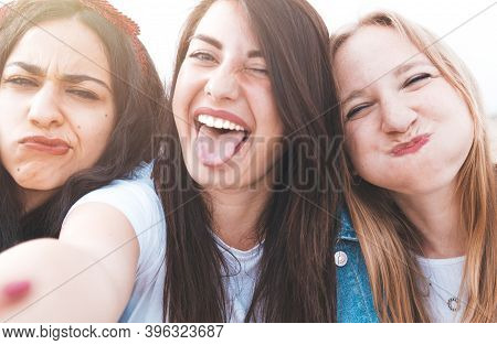Group Of Best Friends On Vacation Take A Selfie - Happy Friends Have Fun Together During The Trip Ta
