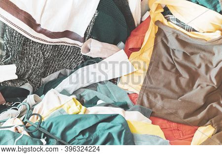 Pile Of Colorful Clothes At A Flea Market - Scattered Clothing In A Vintage Shop