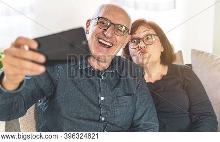 Portrait Of Joyful Senior Married Couple - Retired Couple Enjoying Free Time Taking Funny Selfie - M
