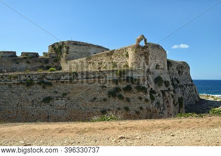 View On The Methoni Venetian Fortress In The Peloponnese, Messenia, Greece. The Coast Of Mediterrane