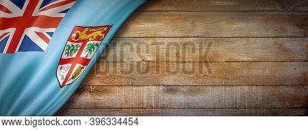 Fiji Flag On Vintage Wood Wall. Horizontal Panoramic Banner. 3d Illustration