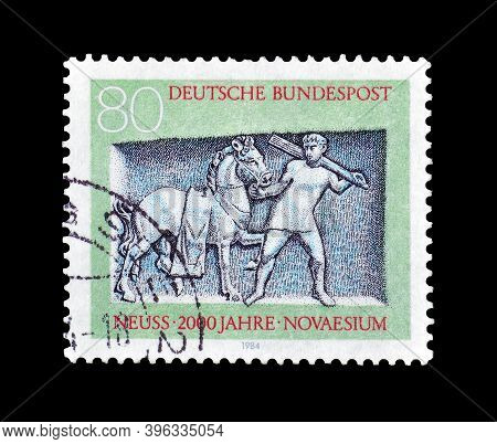 Germany - Circa 1984 : Cancelled Postage Stamp Printed By Germany, That Shows Groom Leading Horse (d
