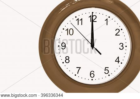 Large Of Brown Color Analog Clock Show 12 Hours At Midnight Or Noon Close-up