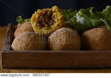 Arancini, Italian Street Food. Fried Balls, Made Of Rice, Meat And Vegetables.