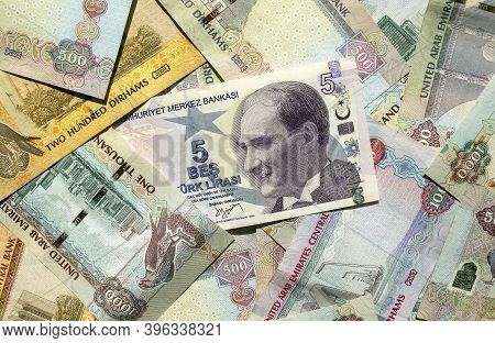 Turkish Lira On Top Of Uae National Currency, Top View Of Mixed Dirhams Banknotes. Aed And Try Money