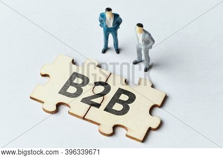 B2b Concept With Puzzle And Two Abstract Persons.