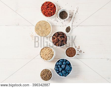 Various Superfoods In Small Bowl On White Wooden Table.selection Super Food.superfood As Blueberry,