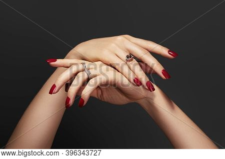 Elegant Female Hands With Bright Manicure. Square Nails With Red Gel Polish. Luxury Fashion Style Of