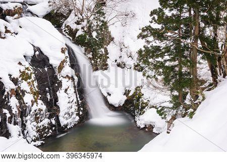 Shirogane Falls in winter near Obanazawa, Yamagata Prefecture, Japan hot springs town in winter season.