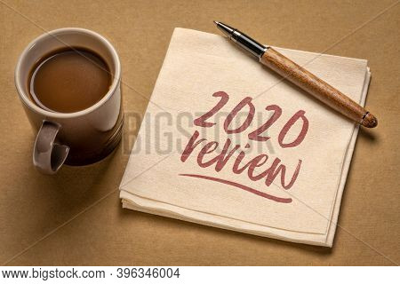 2020 year review - handwriting on a napkin with a cup of coffee, end of year business concept