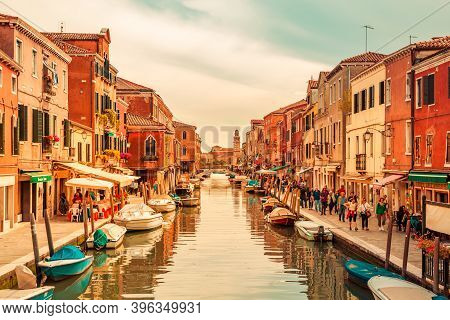 Venice Italy - May 25, 2019: View On Murano Island With The Central Canal, Bridge, Boats, Shops And