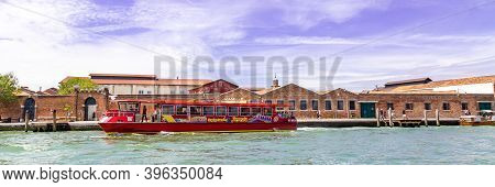 Venice Italy - May 26, 2019: City Sightseeing Water Bus At A Stop Near A Glass Factory On Murano Isl