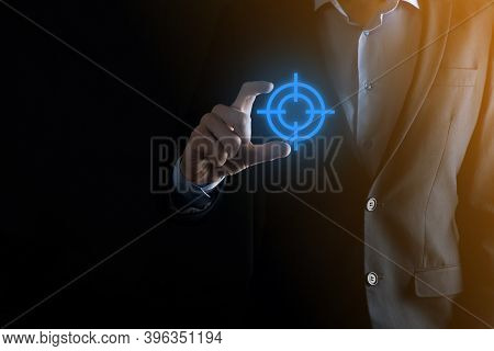 Targeting Concept With Businessman Hand Holding Target Icon Dartboard Sketch On Chalkboard. Objectiv
