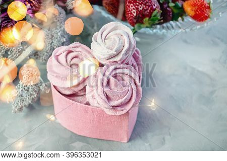 Fresh Handmade Marshmallows In A Light Mood. Close-up Of A Pink Marshmallow In A Pink Heart-shaped G