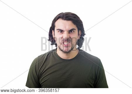 Angry Young Man Reacting Furious, Clenching Teeth Looking Very Angry With Mad Eyes To Camera. Irrita