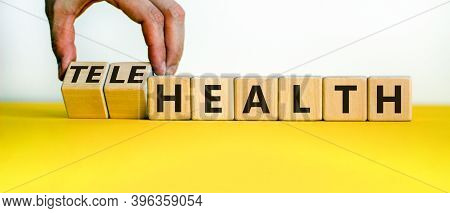 Time To Telehealth. Male Hand Flips Wooden Cubes And Changes The Word 'health' To 'telehealth'. Beau