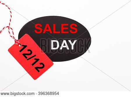 On A Light Background There Are Price Tags. One Day Sale Concept 12.12. Red And Black Price Tags Sal
