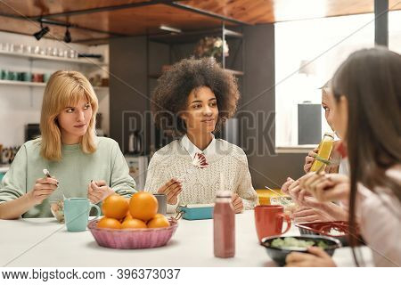 Business Lunch. Two Well-dressed White Young Women Of Different Nationalities Sitting Together At A