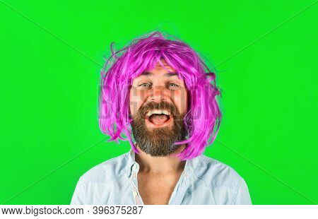 Man In Color Wig. Smiling Man In Curly Wig. Happy Man In Color Wig. Smile. Close Up Portrait Of Smil