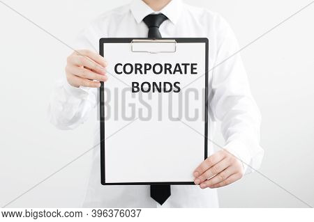 Businessman Holds A Folder With The Inscription Corporate Bonds. Business, Technology, Internet And