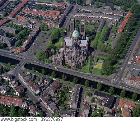 Haarlem, Holland, May 14 - 1992: Historical aerial photo of the Cathedral of Saint Bavo in the city Haarlem in the Dutch province Noord Holland