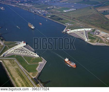 Hoek van Holland, Holland, September 25 - 1997: Historical aerial photo of the open Maeslandkering on the Nieuwe Waterweg to Rotterdam, Holland