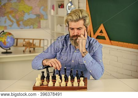 King Of Board Games. Thinking Of Attacking Opponent Chess Pieces. Thinking Of Next Move. Bearded Man