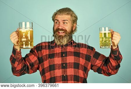 Hipster Drink Beer. Mature Bearded Guy Hold Beer Glass. Cheers Toast. True Sensation. Holiday Celebr