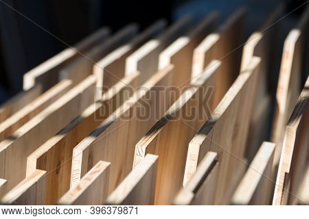 Samples Of Wooden Furniture Mdf Profiles In Sunlight. Selective Focus