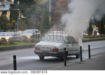 Bucharest, Romania - November 3, 2011: Old Dacia Car Caught Fire In The Middle Of The Street.