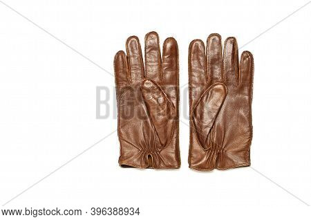Brown Classic Leather Mens Gloves On White Isolated Background Top View. Stylish Fashionable Winter