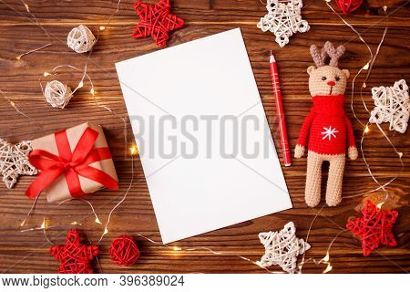 Christmas Composition Greeting Card. Gift With Amigurumi Deer With Decoration And Paper Blank For Go