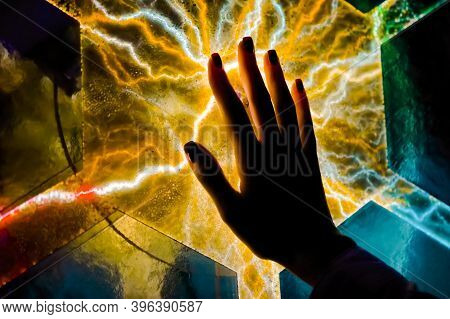Interactive Touchscreen Exposition In Science Museum. Woman Hand Touching Colorful Plasma Panel Disp