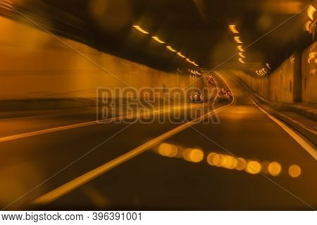 Moving Cars In City Tunnel With Moving Cars At Night, Urban Transportation, Neon Illumination. Blurr
