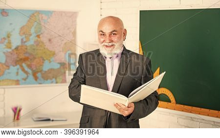 Knowledge And Culture Are Each Dynamic. Teaching Changed. Man Bearded Tutor In Classroom. Main Task