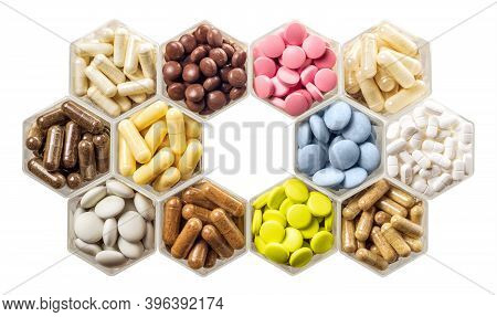 Medical Capsules And Pills In Hexagonal Jars Isolated On White