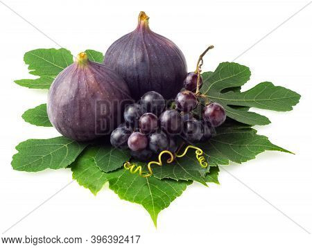 Grapes And Whole Figs Isolated On White