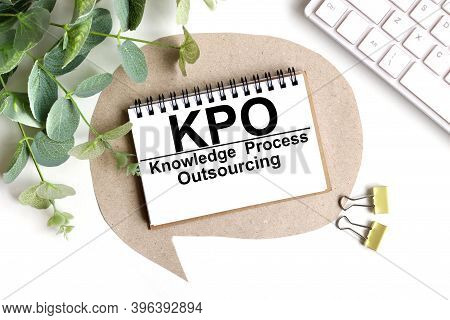 Kpo - Knowledge Process Outsourcing, Text On White Paper On A Light Background Near The Plant