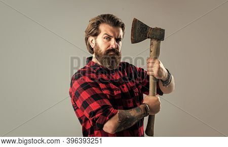 Feel So Confident. Bearded Lumberjack With An Axe. Woodcutter In A Plaid Shirt. Lumberjack Brutal Be