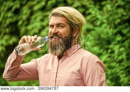 Need Some Drink. Brutal Male Hipster Drink Water. Bearded Man Hold Plastic Bottle Of Water. Feeling