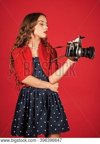 Confident Girl With Retro Camera. Capture Childhood Memories. Slr Camera. Beautiful Child Photograph